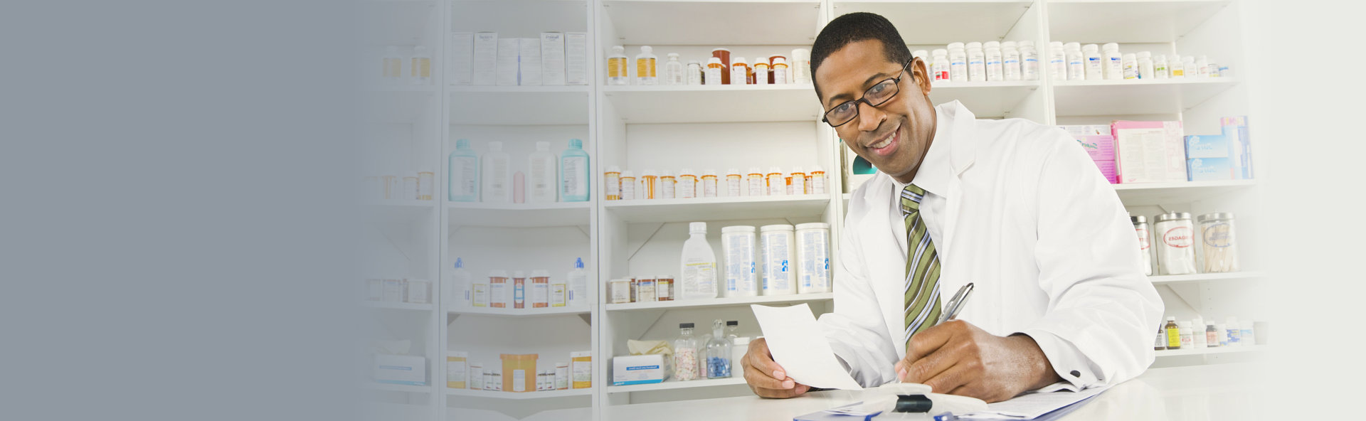 Pharmacist holding a paper and a pen